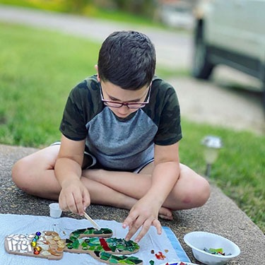 child-creating-a-mosaic