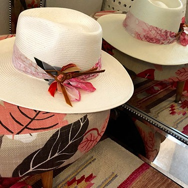 hat with floral hat band